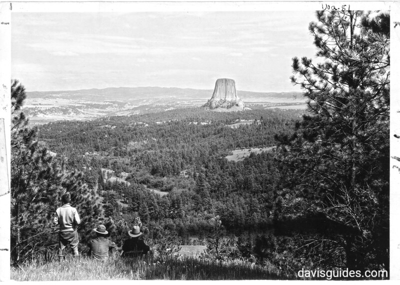 Devils Tower from the edge of the mesa, west of George Weaver's ranch, showing surrounding wooded area. Devils Tower National Monument, 1930.