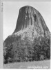 Close-up of Devils Tower from the southeast side, showing columnar structures. Devils Tower National Monument, 1933.