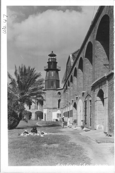 Lighthouse at Fort Jefferson from inside fort. On right is entrance to fort from sally port and drawbridge. Dry Tortugas National Monument, 1937.