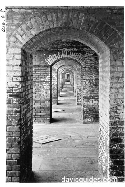 The narrow archways on the second gallery have rounded tops at Fort Jefferson. Dry Tortugas National Monument, 1937.