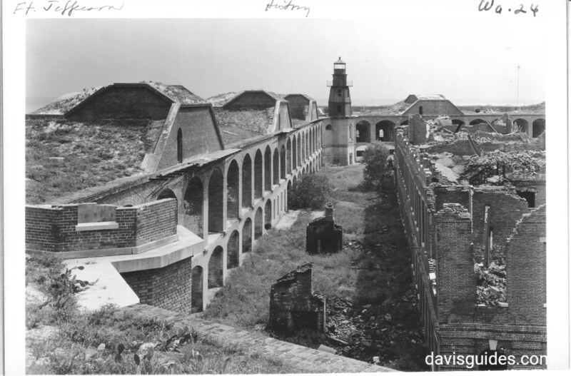 View of interior of Fort Jefferson showing lighthouse. Dry Tortugas National Monument, 1937.