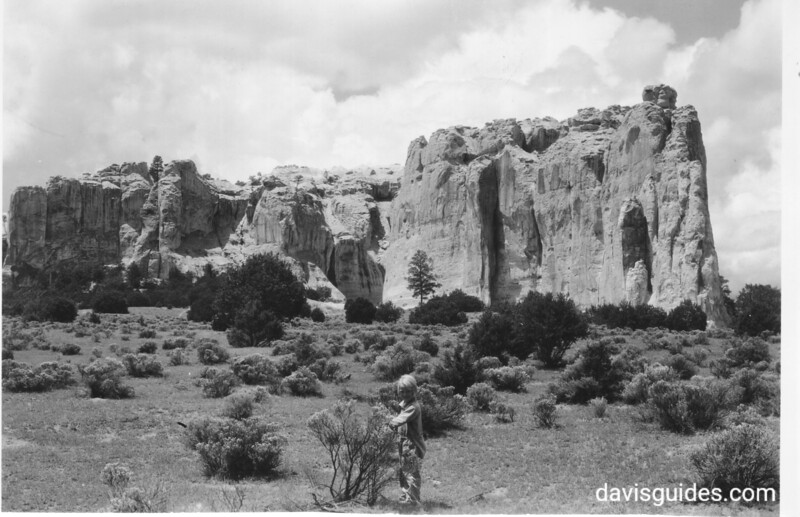 Inscription Rock from the east side. Joan Vogt in the foreground. El Morro National Monument, 1929.