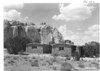 Administration Building and custodian's residence near the base of the famous Inscription Rock, on which travelers started carving their names and information on their expeditions more than three centuries ago. El Morro National Monument, 1940.