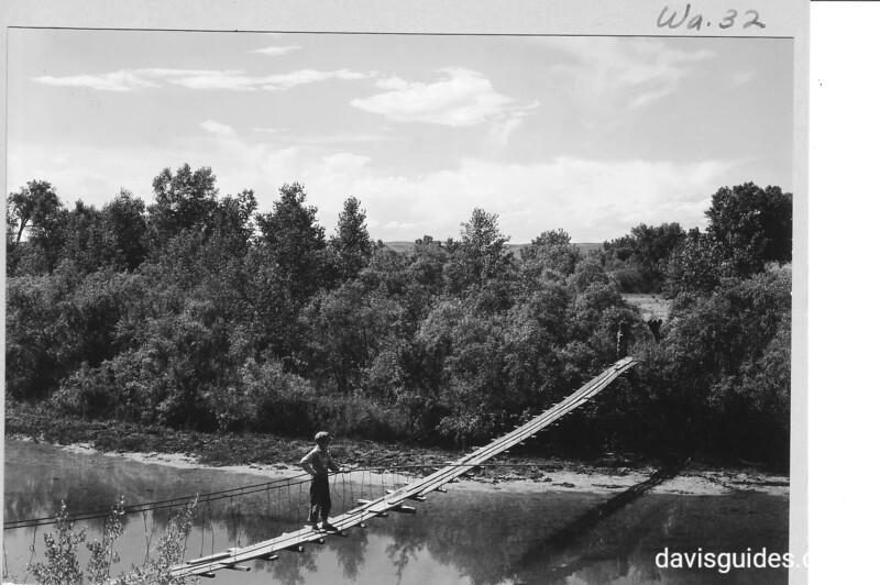Swing bridge across Laramie River south of the fort. Said to have been built by Fort Laramie soldiers. Fort Laramie National Historic Site, 1932.