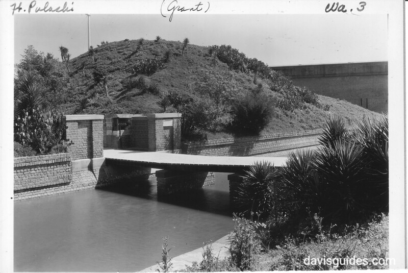 Moat, drawbridge and entrance to the demilune of the fort. Fort Pulaski National Monument, 1937.