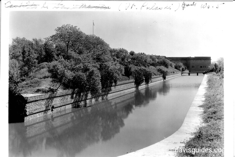 Moat around the Demilune of the fort, showing corner bastion of the fort in the distance. Fort Pulaski National Monument, 1937.