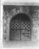 Old wooden door inside the sally port o the fort. Door is on the inside of the gorge, or throat, of fort, facing the parade ground. Fort Pulaski National Monument, 1937.