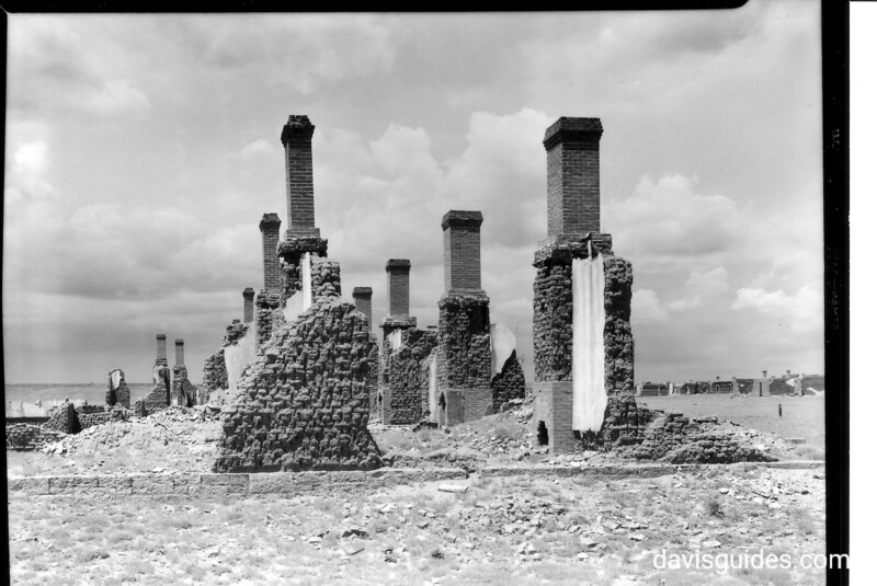 Chimneys and walls of officer's quarters on southwest corner of the parade ground. Fort Union National Monument, 1939.