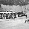 CCC enrollees preparing to leave for worksite in tourist buses. Rocky Mountain National Park, 1933.