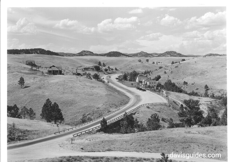 A view of park road and CCC-built visitor center and headquarters building. Wind Cave National Park, 1936.