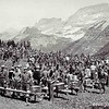 Fortunate CCC workers enjoy lunch near the mountain grandeur of Logan Pass. Glacier National Park, 1933.