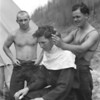 CCC enrolled getting a haircut from a fellow worker, Glacier National Park, 1933.