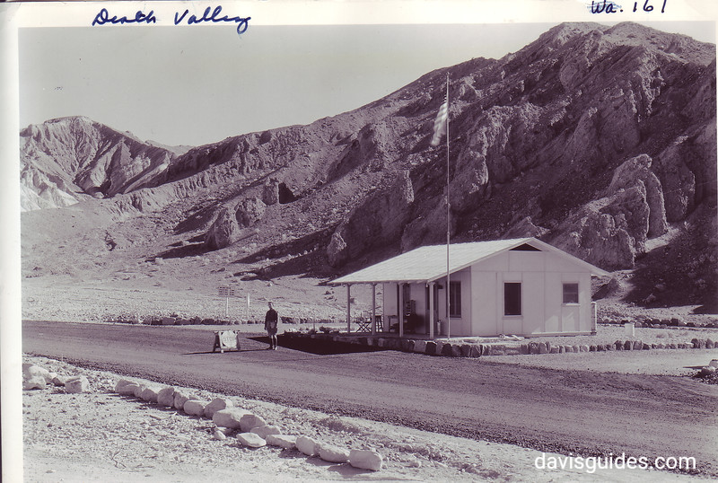 CCC enrollee staffing the entrance check station near Furnace Creek Wash. Death Valley National Park, 1935.