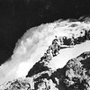 Tourist enjoy dramatic view of the falls of the Yellowstone River from CCC-built overlook.  c. 1939.