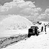 CCC crew clearing snow from Trail Ridge Road. Rocky Mountain National Park, 1933.