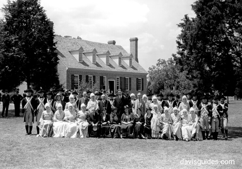 Interior Secretary Ray Wilbur (center, standing), and a group of Colonial Dames, Monticello Guards, and members of the official party (including Horace Albright, standing sixth from left) at the dedication of Memorial House, George Washington Birthplace National Monument, 1932.