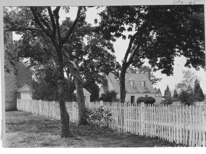 Picket fence at north end of the mansion, with kitchen between the trees. George Washington Birthplace National Monument, 1932.