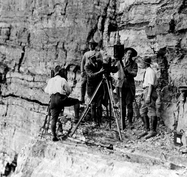 George Grant (behind large format camera) and others on the Ptarmigan Wall. Glacier National Park, 1932.