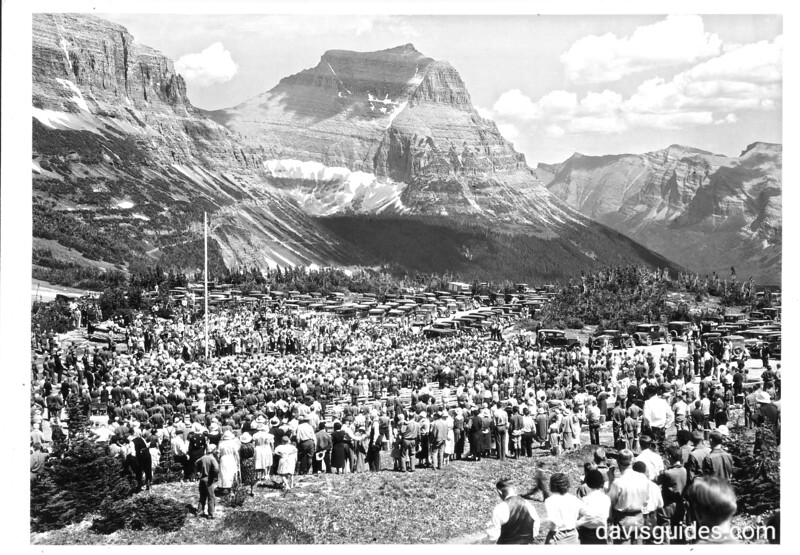 """Gathering at the summit of Logan Pass during the dedication of the Going to the Sun Road. The crowd is singing """"America the Beautiful"""". Glacier National Park, July 15, 1933."""