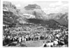 "Gathering at the summit of Logan Pass during the dedication of the Going to the Sun Road. The crowd is singing ""America the Beautiful"". Glacier National Park, July 15, 1933."