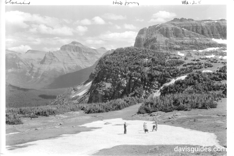 Visitors in snow at summit of Logan Pass. Glacier National Park, 1932.