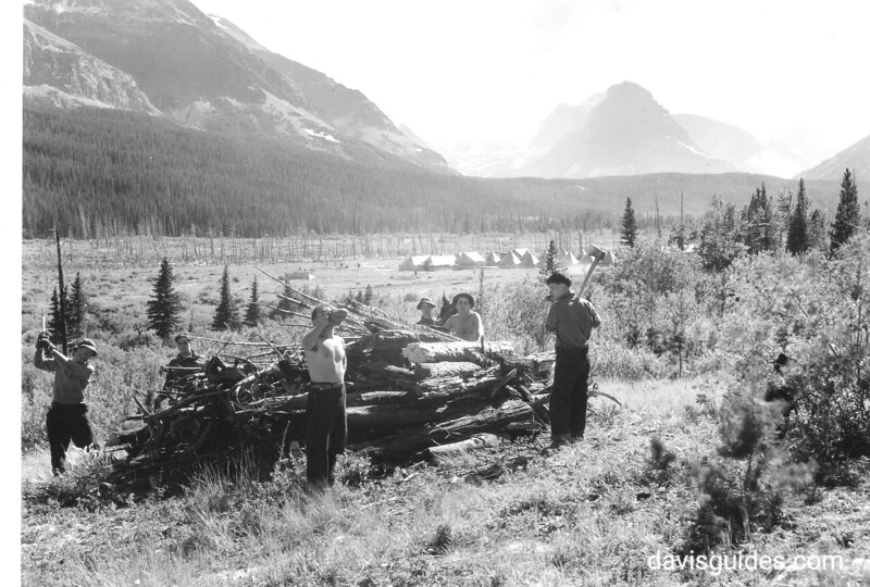 CCC enrollees clearing downed wood and debris, Glacier National Park, 1933.