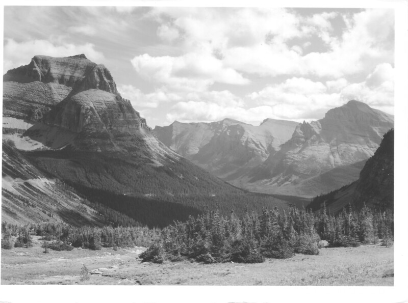 The Upper St. Marys Valley from the summit of Logan Pass. Going to the Sun and Little Chief Mountains. Glacier National Park, 1940.