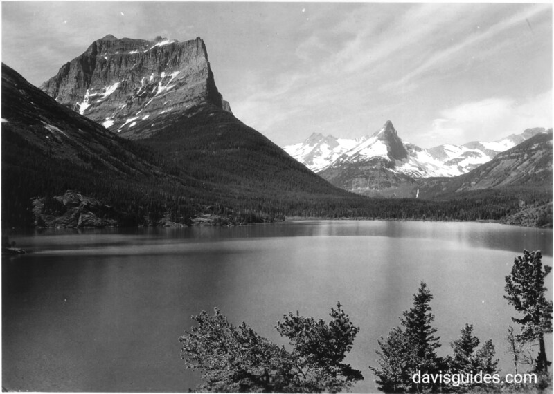 Citadel and Fusilade Mountains from the trail near Going to the Sun Chalets, Upper St. Marys Lake. Glacier National Park, 1933.