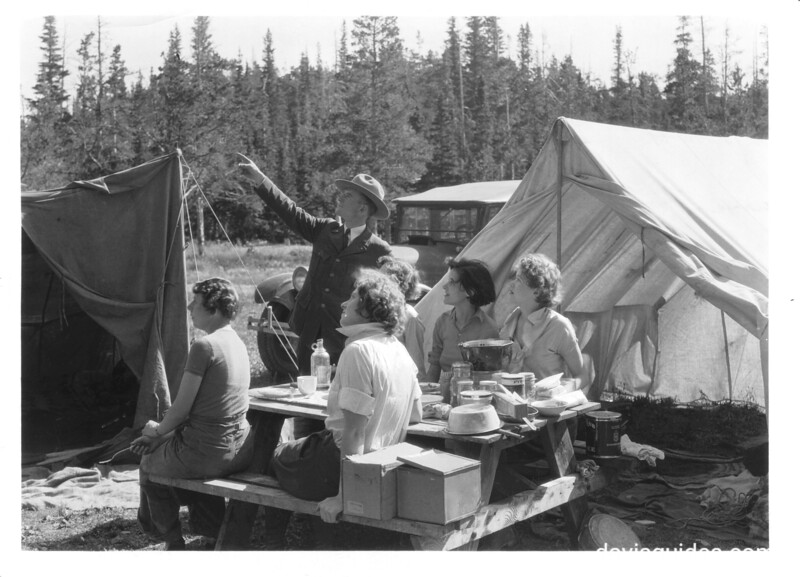 Park Service naturalist with girls camping at Two Medicine Campground. Glacier National Park, 1932.