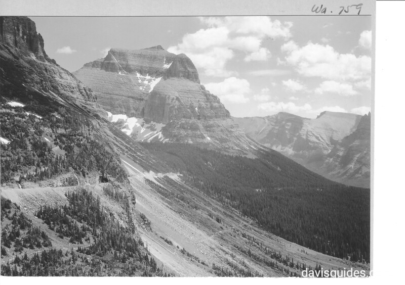 View east from the summit of Logan Pass showing the highway grade and tunnel  on Going to the Sun Mountain. Glacier National Park, 1933.
