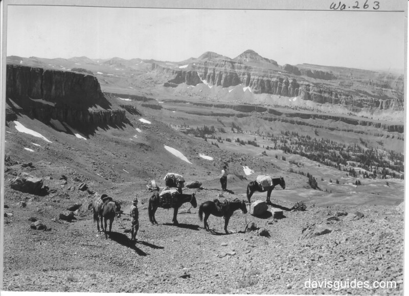 View from Alaska Basin, head of the main fork of Teton Canyon, from saddle at head of Cascade Canyon, showing sedimentary layers on west side of range. Grand Teton National Park, 1933.