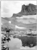 Limestone cliff and head of Cascade Canyon reflected in pool near the trail. Grand Teton National Park, 1933.