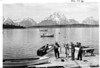 Skipper displaying a 7 1/2 lb. cut-throat trout, native, caught from the dock. Grand Teton National Park, 1941.