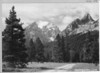 Teewinot, the Grand Teton, Mount Owen, Glacier Canyon and Symmetry Spire from the road into String Lake. Grand Teton National Park, 1930.
