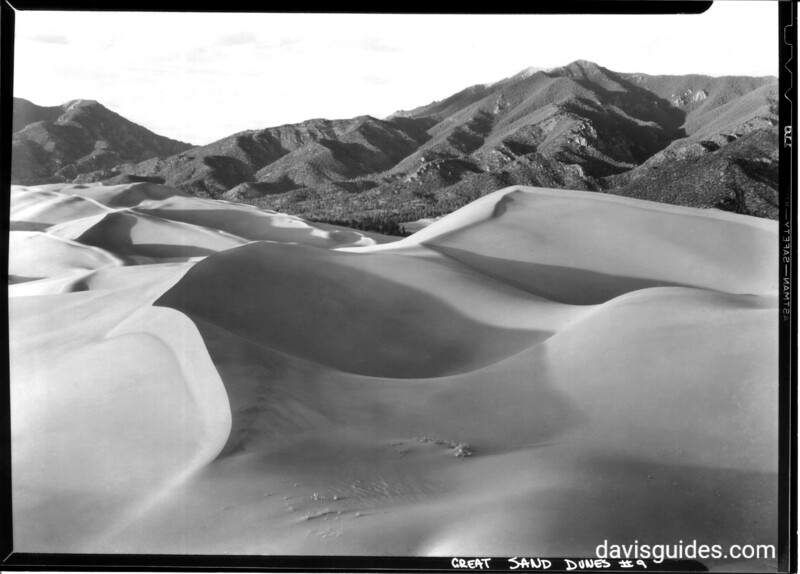 An intimate view of a great sand dune looking toward the Sangre de Cristo Mountain range. Great Sand Dunes National Monument, 1940.