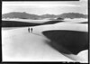 Visitors walking on the great sand dunes, Great Sand Dunes National Monument, 1939.