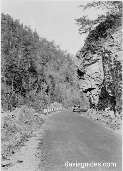 Overhanging cliff along the highway between Townsend and Gatlinburg. Planned Great Smoky Mountains National Park, 1931.