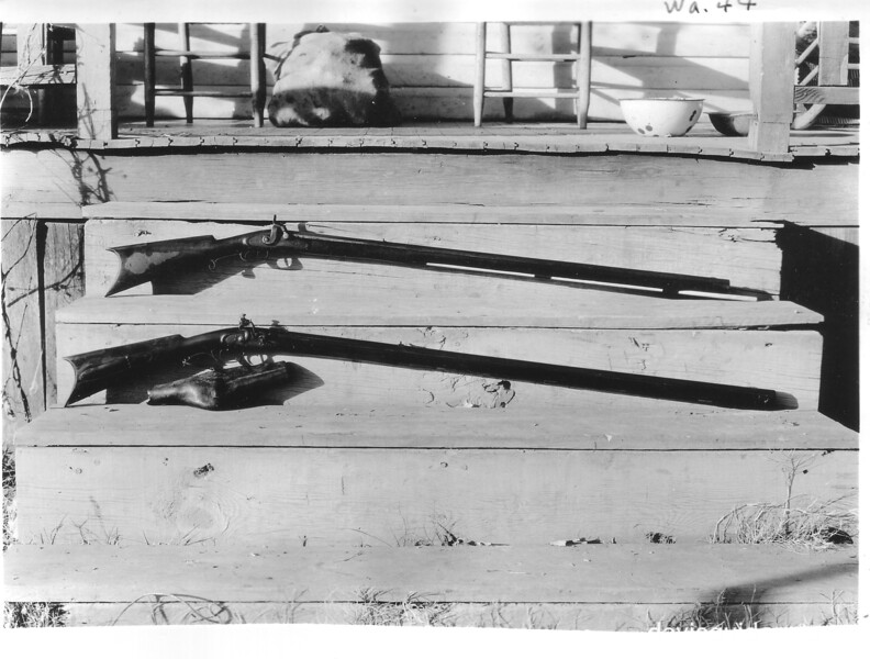 Two old muzzle loading rifles belonging to Mr. John Olezer in Cades Cove. The lower is an old flintlock. Planned Great Smoky Mountains National Park, 1931.