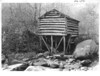 Silas Bracken's mill below Indian Gap Hotel from the creek showing sluice power wheel and shaft below. Planned Great Smoky Mountains National Park, 1931.