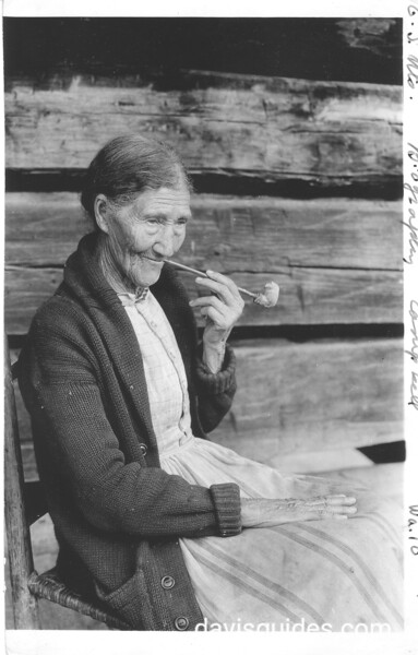 Aunt Sophie Campbell on porch of her home near Gatlinburg. Planned Great Smoky Mountains National Park, 1931.