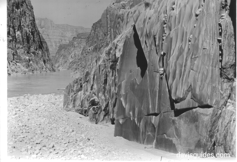 Pot holes in granite along north wall of Separation Rapids. This view is downstream and shows part of the Colorado River Gorge. Lake Mead National Recreation Area, 1939.