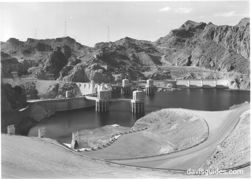 View of Hoover Dam with entrance road and parking areas, along with four intake towers and Nevada Spillway. Lake Mead National Recreation Area, 1939.