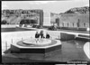Visitors touring newly opened Boulder (Hoover) Dam, near the octagonal platform surmounted by signs of the Zodiac. Lake Mead National Recreation Area, 1939.