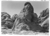 Valley of Fire. Note the pictographs near the figure of Bob Rose. Lake Mead National Recreation Area, 1937.