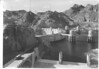 View of Hoover Dam from the Arizona side showing entrance highway and four intake towers and Nevada Spillway. Lake Mead National Recreation Area, 1939.