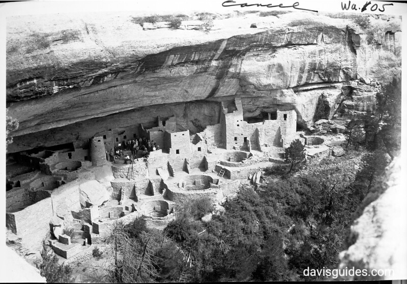 Tourists at Cliff House. Photo taken from a cliff above. Mesa Verde National Park, 1929.