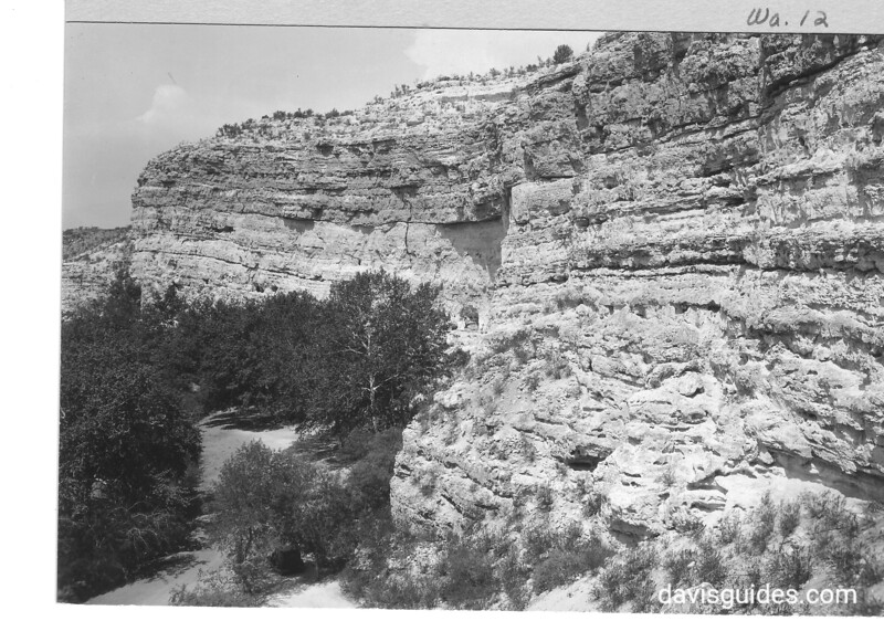 Looking west along cliff from Castle, showing recess where 2nd ruin is located. Montezuma Castle National Monument, 1929.
