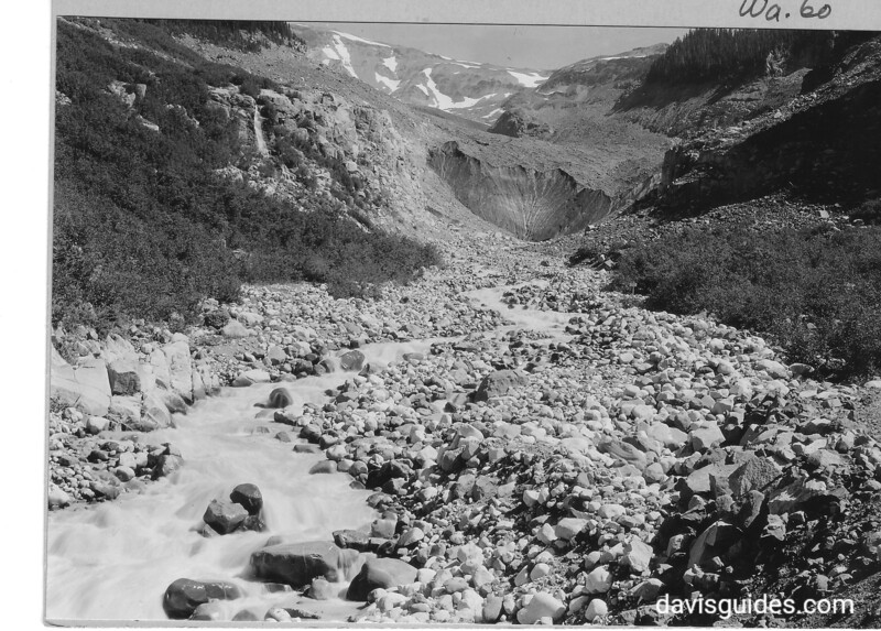 View north from bridge toward summit of Nisqually Glacier. Nisqually River in foreground. Mount Rainier National Park, 1932.