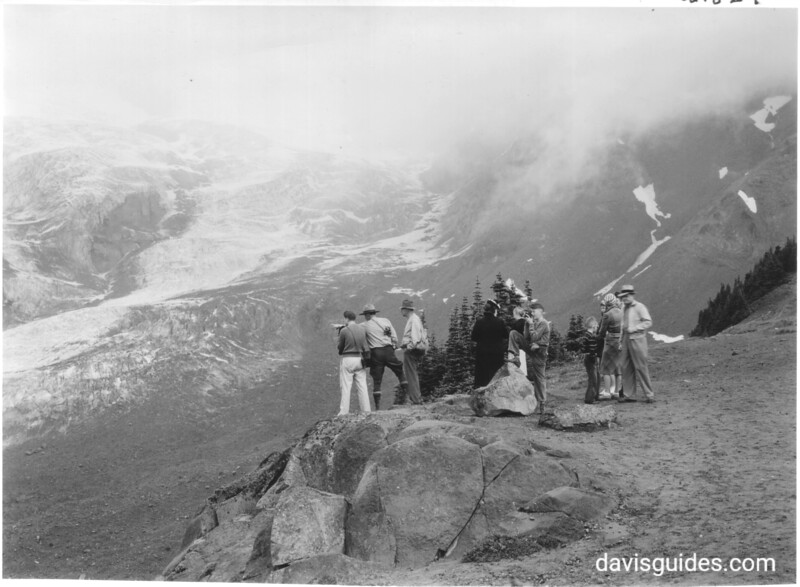 Park naturalist with a group of visitors at Glacier Vista. Mount Rainier National Park, 1941.