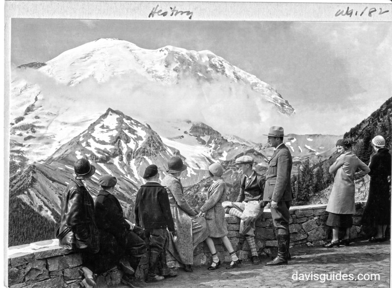 Grace Albright, wife of Horace Albright, with children Marian  and Bob, with Superintendent Owen Tomlinson and his family at the lookout point on the loop trail north of Sunrise Lodge. Mount Rainier National Park, 1932.